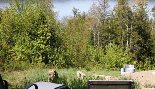Vue sur le lac - foyer extérieur